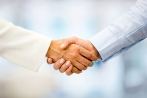 Successful business people handshaking closing a deal