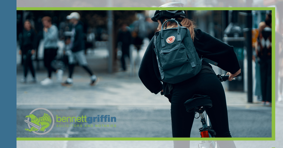 Young person on a bike in a city